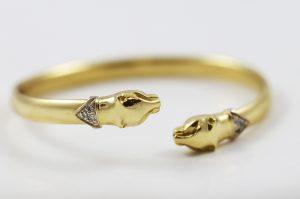 Luxusní zlatý náramek dvě pumy
