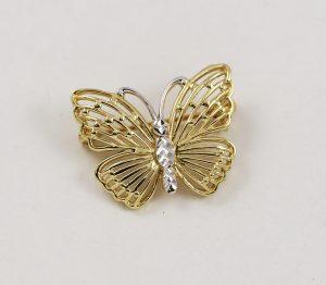 Zlatá brož motýlek