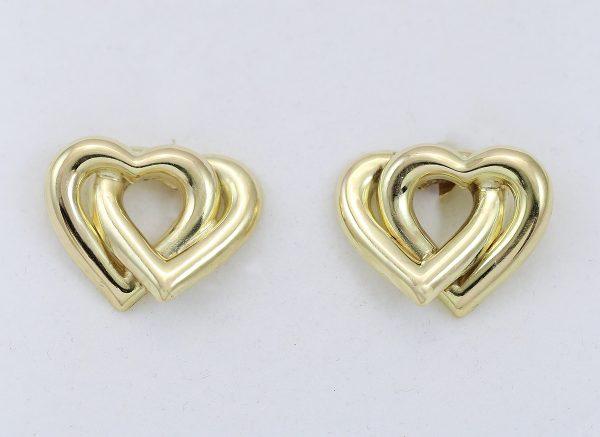 Zlaté náušnice propojená srdce